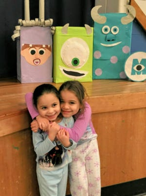 Sisters Amalia and Malaia Small enjoyed a movie in their PJs during the KLR PTO's family monster movie night on Feb. 12.