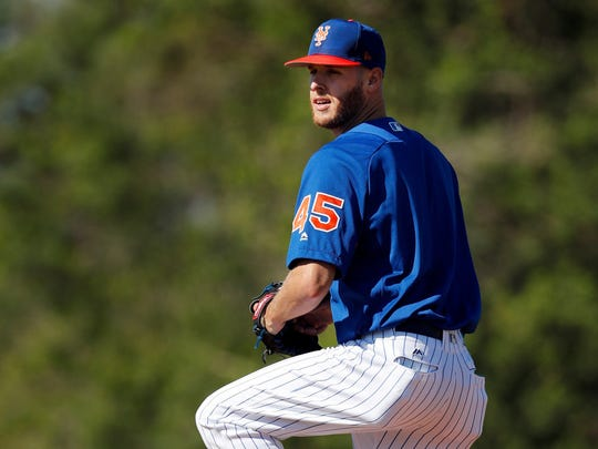 New York Mets pitcher Zack Wheeler takes part in a drill during spring training baseball practice Friday, Feb. 16, 2018, in Port St. Lucie, Fla.