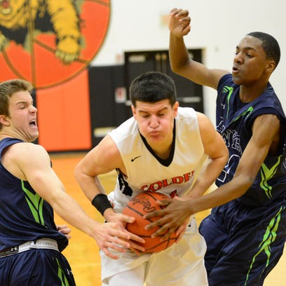 Gibsonburg's Nick Kille goes through Maumee Valley