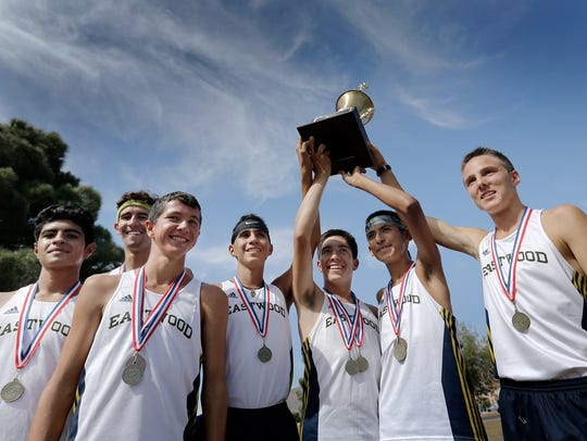 The Eastwood cross country team celebrates their District