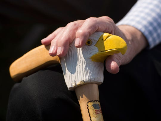 Each cane handle shows the history of the individual veteran's service to his country, including details about the individual's service branch, awards earned and dates of enlistment and discharge.