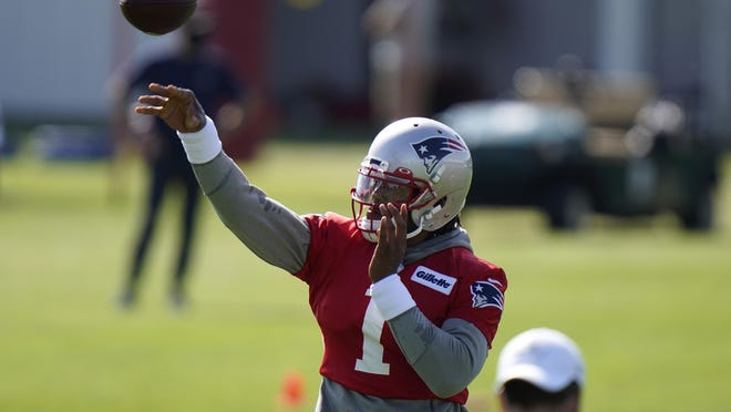Patriots quarterback Cam Newton passes the ball during a drill at training camp Wednesday in Foxboro.