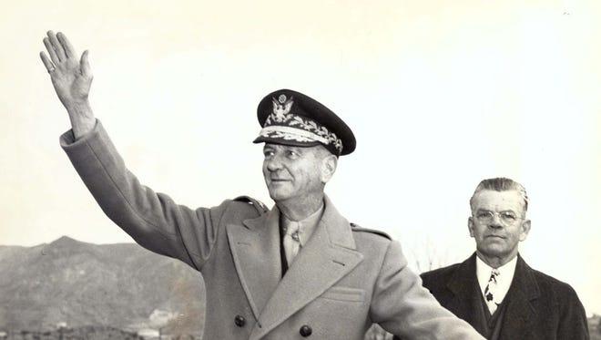 Gen. John M. Wainwright waves Dec. 13, 1945, to cheering El Paso crowds. He is shown with Mayor Pro Tem Dan Duke.