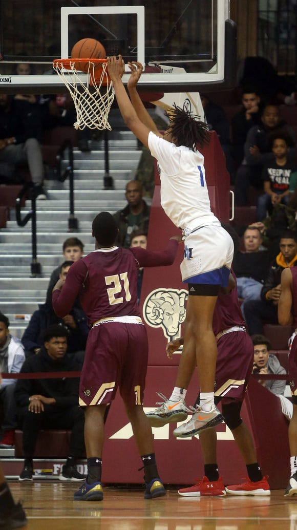 Moses Brown of Archbishop Molloy dunks over Josh Alexander