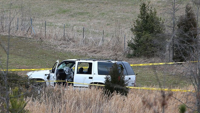 Police tape surrounds a sport-utility vehicle March 16, 2017, near the eastbound U.S. 412 offramp at Tennessee 88 in Alamo, Tenn.
