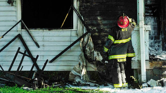 Firefighters work at a house fire on Georgia Avenue early Wednesday morning in Nashville.
