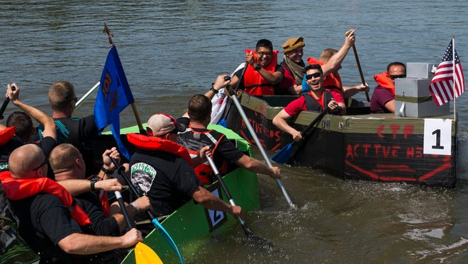 Members of Company 5-101 ABN Reg and Active Heroes  clash during their cardboard regatta race at Riverfest.