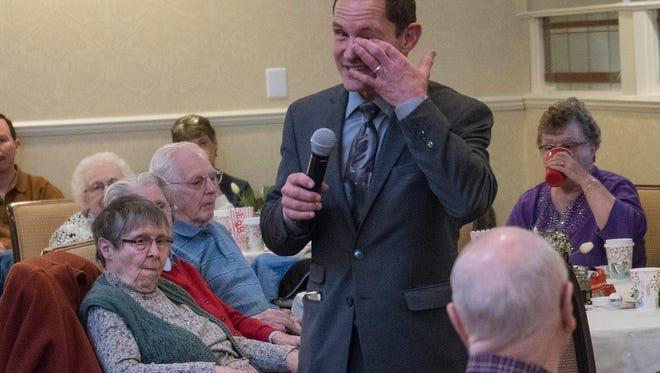Dr. Murray Howe gets emotional during his presentation, while speaking of his dad, hockey great Gordie Howe.