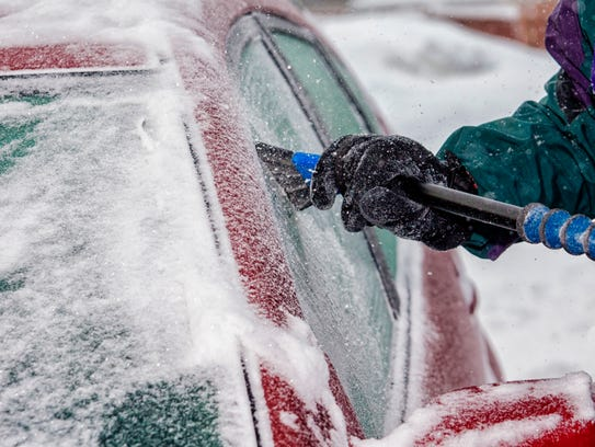 Completely clearing your car of snow and ice can keep