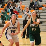 Wyoming senior Emily Wadds (42) fights for a rebound against sophomore Kaitlin Ricke of Batavia on Feb. 24.