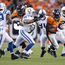Denver Broncos Montee Ball runs past the Colts defense in the first half.  The Indianapolis Colts play the Denver Broncos Sunday, September 7, 2014, evening at Sports Authority Field at Mile High in Denver CO.
