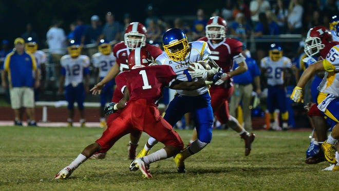 Sussex Central's Tynez Warner with the run against Laurel High School on Friday, Sept. 9, 2016. in Laurel, De.