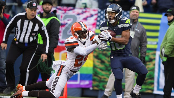 Seattle Seahawks wide receiver Tyler Lockett, right, pulls in a touchdown with the Cleveland Browns' Johnson Bademosi on his arm in the third quarter at CenturyLink Field in Seattle on Sunday, Dec. 20, 2015. The Seahawks won, 30-13.