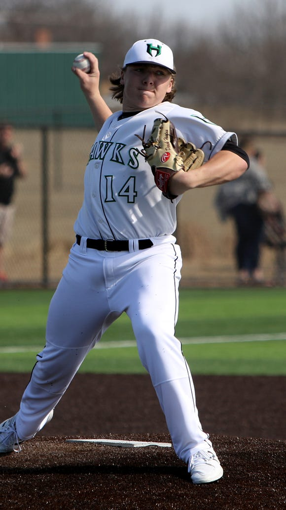 Iowa Park pitcher Derek Hostas throws to first on a pick-off attempt against Holliday in the Iowa Park Tournament Saturday, March 3, 2018, in Iowa Park. The Hawks defeated the Eagles 9-0.