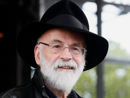 FILE - This is a Tuesday, Oct. 5, 2010 file photo of British author Terry Pratchett seen at the Conservative party conference in Birmingham, England. Fantasy writer Pratchett, creator of the  Discworld  series died Thursday March 12, 2015 aged 66. Pratchett, who suffered from a very rare form of early onset Alzheimer's disease, had earned wide respect throughout Britain with his dignified campaign for the right of critically ill patients to choose assisted suicide.