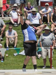 Danbury's Kain Lucas throws the shot put Friday during the Division III state meet at Jesse Owens Memorial Stadium.