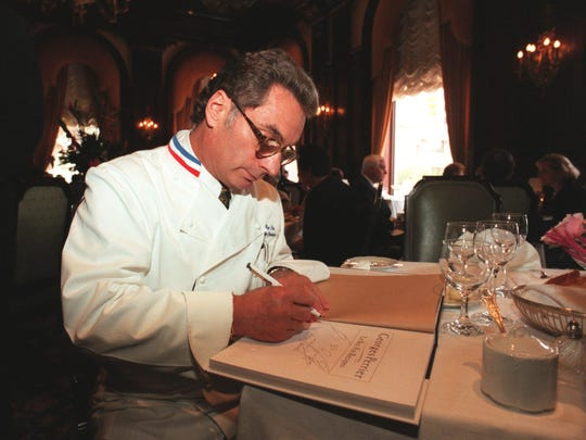 In this 1997 photo, former Le Bec Fin owner Georges Perrier signed copies of his cookbook at the Hotel du Pont's Green Room
