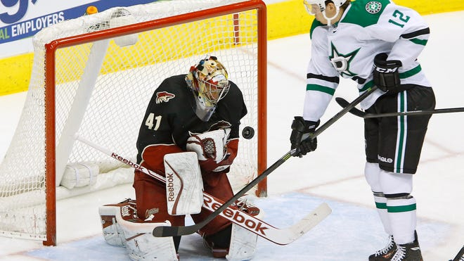 Coyotes goalie Mike Smith (41) makes a save against Dallas Stars right wing Alex Chiasson during the first period of their game Feb. 4, 2014, in Glendale.