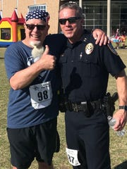 Stan Standridge (without beard), chief of the Abilene Police Department, ran his CASA 5K in full uniform. That included a protective vest and his gun. Newspaper columnist Greg Jaklewicz (without badge) gives the chief a thumb's up for that superheroic effort.