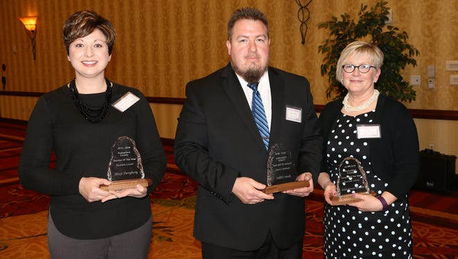 From left to right, Lascassas Elementary teacher Alexis Derryberry, Rock Springs Middle teacher James Elliott and Riverdale High teacher Edith Urness-Pondillo were named Rutherford County grade-level teachers of the year at a reception in Murfreesboro last week.