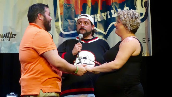 Filmmaker/comedian Kevin Smith, center, presided over wedding of Shands Massey and Emily Blankenship at Zanies comedy club in Nashville, May 19, 2016