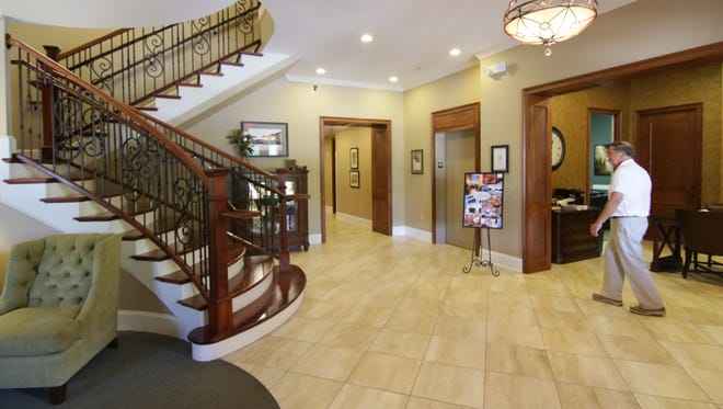 Bleckley Inn owner Steve Kay walks in the lobby of his boutique hotel at 151 East Church Street in Anderson.