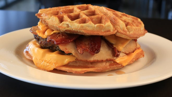 Rethinking the bun is part of the game plan for the Wisconsin Timber Rattlers culinary team for the 2017 season, including this 1-pound bacon cheeseburger served between waffles.