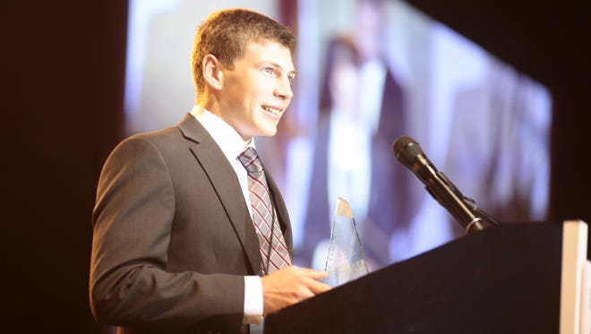 Teurlings Catholic's George Femmer accepts his award as the High Achiever of the Year during the second Sports Awards held Wednesday at the Cajundome.