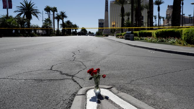 Flowers are placed near the scene of a mass shooting on Oct. 2, 2017, that occurred at a music festival near the Mandalay Bay resort and casino on the Las Vegas Strip in Las Vegas.