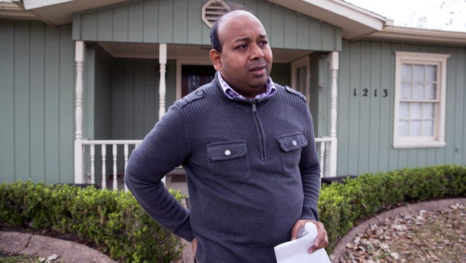 Janson Abraham, pastor of Kingdom Acts Ministries International, speaks to the media Thursday, Feb. 8, 2018 outside his home, which is also where many of the ministry's services take place. A man believed to be in his 30s is in police custody after four people were stabbed during a church service Wednesday, Feb. 7, 2018, inside the residence in the 1200 block of Cambridge Drive in Corpus Christi. One man died Thursday from his wounds.