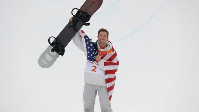 Shaun White celebrates winning the gold medal in the men's halfpipe finals at Phoenix Snow Park at the 2018 Winter Olympics in Pyeongchang, South Korea.