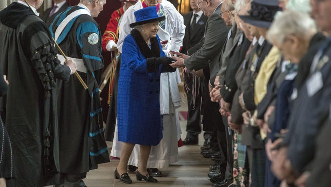 Queen Elizabeth II distributes the traditional Maundy money during the Royal Maundy Service at St George's Chapel on March 29, 2018 in Windsor.