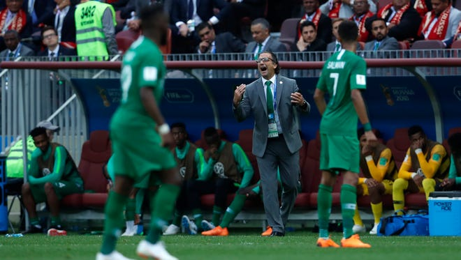 Saudi Arabia head coach Juan Antonio Pizzi shouts out to his players during the group A World Cup match against Russia in Moscow.