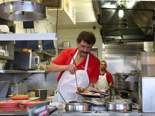 PHOTOS BY Jay Calderon/The Desert Sun El Rincón Norteño cook Eddie Villarreal prepares breakfast plates at the long-running Indio restaurant.  The California Legislature will consider a measure that would eventually increase the state's minimum wage to $15 an hour,  a move that could affect the region's hospitality industry.
