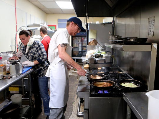 March 16, 2017 - Chef Joe Rawlings (center) preparing lunch dishes at Pharm2Fork, located in Collierville.