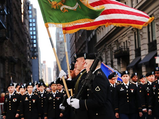 Members of the U.S. military march in the nation's