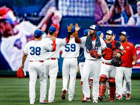 St. Louis Cardinals injured pitcher Alex Reyes (middle)