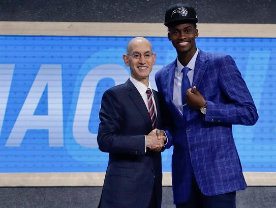 Jonathan Isaac, right, poses for photos with NBA Commissioner