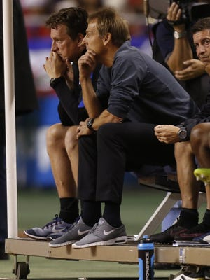 United States coach Jurgen Klinsmann, center, sits on the bench during a World Cup qualifying match against Costa Rica Tuesday.