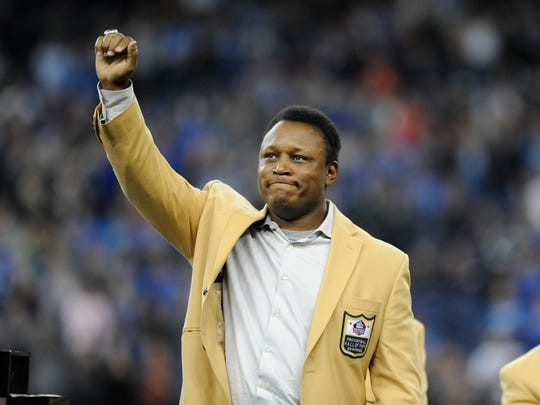 Barry Sanders acknowledges the crowd after receiving a Pro Football Hall of Fame ring during a ceremony at halftime of a game between the Detroit Lions and the Chicago Bears on Oct. 18, 2015, in Detroit.