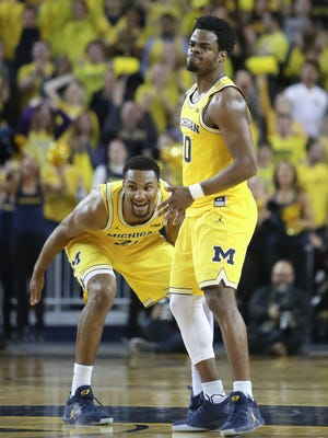 Michigan guard Derrick Walton Jr., right, and Zak Irvin react after a basket against Ohio State during the second half of U-M's 70-66 loss Saturday, Feb. 4, 2017 at Crisler Center.