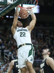 Michigan State's Miles Bridges dunks against Purdue