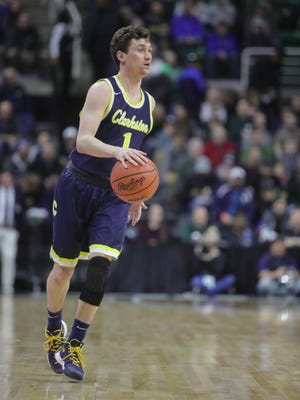 Clarkston guard Foster Loyer brings the ball upcourt against Warren De La Salle during the first half of the Class A MHSAA semifinals Friday, March 23, 2018, at the Breslin Center in East Lansing.