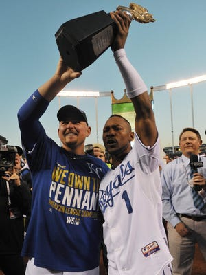 Kansas City Royals center fielder Jarrod Dyson (1) and designated hitter Billy Butler (left) hoist the American League championship trophy after Game 4 of the 2014 ALCS  against the Baltimore Orioles at Kauffman Stadium.
