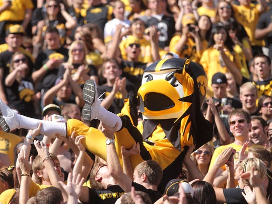 Fans welcome Herky the Hawk into the stands during Iowa's game against Minnesota at Kinnick Stadium on Saturday, Sept. 30, 2012.  Iowa won, 31-13.