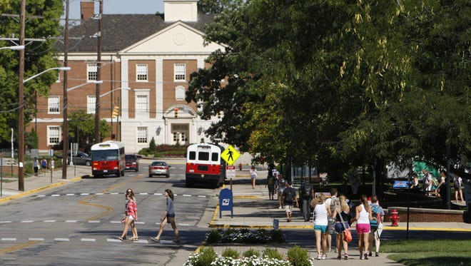 Miami University students make their way along Spring Street in Oxford.
