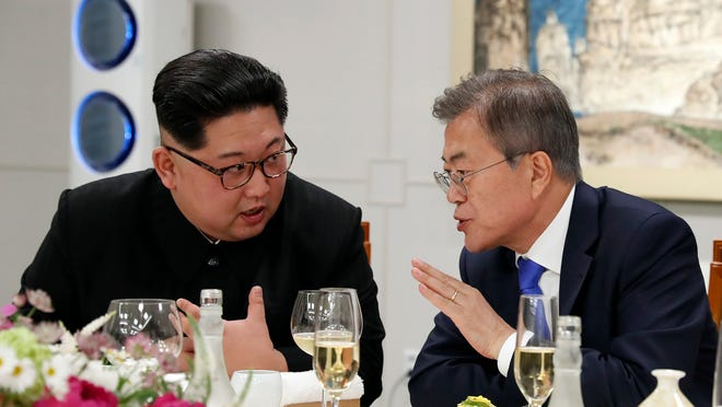 In this April 27, 2018 photo, North Korean leader Kim Jong Un, left, and South Korean President Moon Jae-in talk during a banquet at the border village of Panmunjom in the Demilitarized Zone, South Korea. North Korean leader Kim Jong Un and South Korean President Moon Jae-in have met on Saturday, May 26, 2018 for the second time in a month to discuss peace commitments they reached in their first summit and Kim's potential meeting with President Donald Trump. (Korea Summit Press Pool via AP)