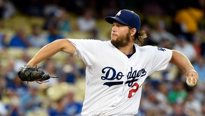 Los Angeles Dodgers starting pitcher Clayton Kershaw (22) pitches during the first inning against the Chicago Cubs at Dodger Stadium.