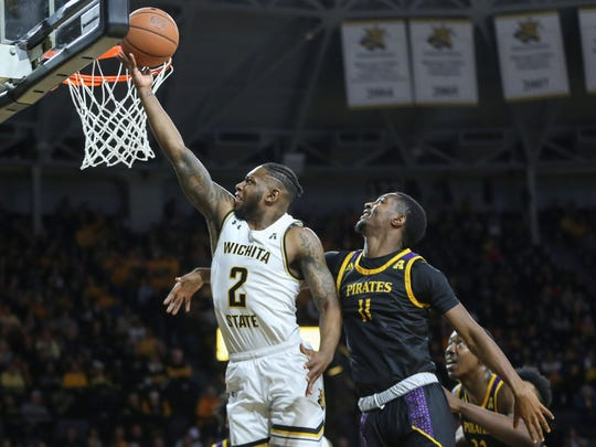 Wichita State's Jamarius Burton makes a layup against East Carolina's JJ Miles during the first half of an NCAA college basketball game on Jan. 1 in Wichita, Kan. Burton elected to transfer to Texas Tech on Monday.