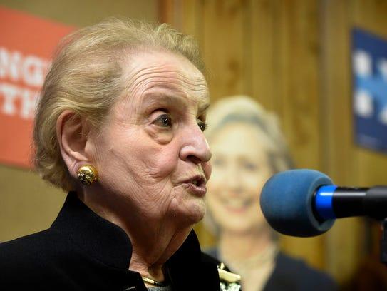 Former Secretary of State Madeleine Albright, backdropped